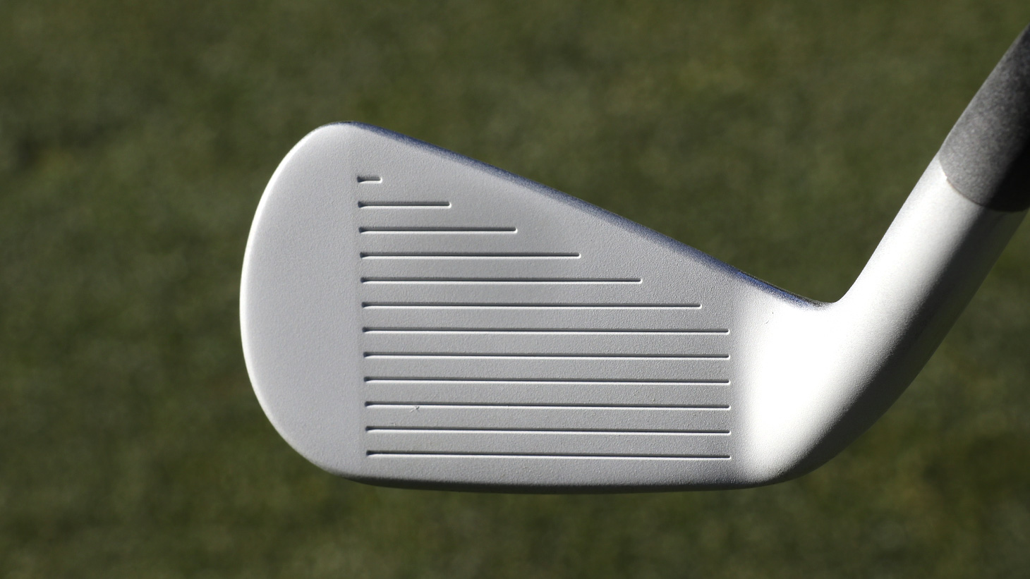 Club face after a thin coating of foot spray.