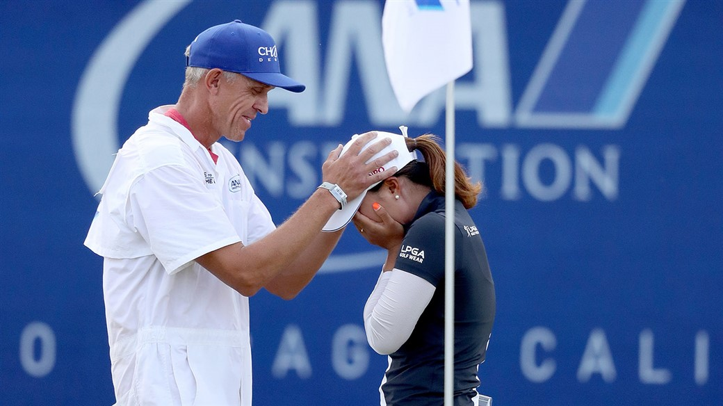 Titleist Pro V1 golf ball player Jin Young Ko celebrates with her caddie after holing the final putt to win the 2019 ANA Inspiration